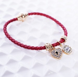 RED BRAIDED FEBE BRACELET WITH ZIRCONS ON CHARMS